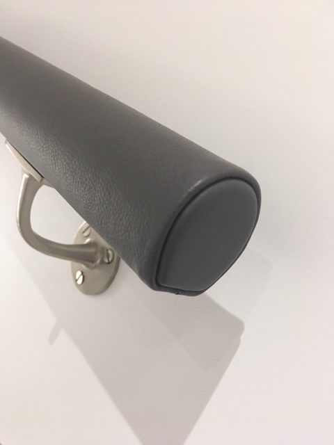 dark grey leather covered handrail