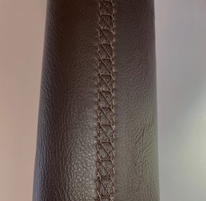 Hand stitched leather handrail